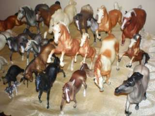 LOT OF 24 BREYER HORSES & A BEAR DIFFERENT SIZES & COLORS MADE IN THE